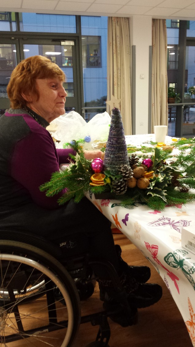 Tutor Joyce, overseeing Table Decorations in the making.